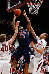 February 3, 2011; Stanford, CA, USA;  Arizona Wildcats forward Jesse Perry (33) shoots past Stanford Cardinal forward/center John Gage (40) and forward/center Josh Owens (13) during the second half at Maples Pavilion.  Arizona defeated Stanford 78-69.