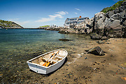 A small rowboat is pulled up on the shores of swim beach on Monhegan Island.