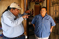 Verlon Jose, vice-chairman of the Tohono O'odham Nation (L,) talks to his cousin Francine Jose on her family ranch near the U.S.- Mexico border on the Tohono O'odham reservation in Chukut Kuk, Arizona April 6, 2017. Picture taken April 6, 2017.  REUTERS/Rick Wilking