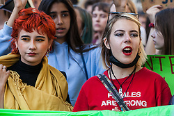 London, UK. 20 September, 2019. Anna Taylor (r), co-founder of UK Student Climate Network, marches with students and climate campaigners during the second Global Climate Strike in protest against a lack of urgent action by the UK Government to combat the global climate crisis. The Global Climate Strike grew out of the Fridays for Future movement and is organised in the UK by the UK Student Climate Network.