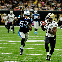 Oct 16, 2016; New Orleans, LA, USA; New Orleans Saints wide receiver Brandin Cooks (10) catches a touchdown past Carolina Panthers outside linebacker Shaq Green-Thompson (54) during the fourth quarter of a game at the Mercedes-Benz Superdome. The Saints defeated the Panthers 41-38. Mandatory Credit: Derick E. Hingle-USA TODAY Sports