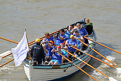 © Licensed to London News Pictures. 07/09/2013. Over 300 craft take to the river for the annual Great River Race. The 21-mile route starts at Docklands and ends at Richmond, where the Queen's rowbarge Gloriana was moored to greet everyone that finished London's RIver Marathon.  Credit : Rob Powell/LNP