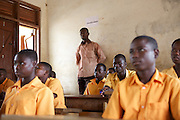 Michael Zoogah, head teacher, monitoring his teachers classes at Tonga Junior High School in Talensi Nabdam, Ghana.