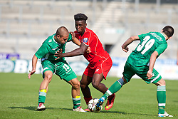 LIVERPOOL, ENGLAND - Tuesday, September 16, 2014: Liverpool's Sheyi Ojo in action against PFC Ludogorets Razgrad's Veselin Lyubomirov and Kristiyan Milhaylov during the UEFA Youth League Group B match at Langtree Park. (Pic by David Rawcliffe/Propaganda)