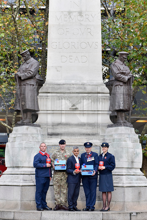 © Licensed to London News Pictures. 31/10/2017. London, UK.  (L to R) Andy Kent (TFL), Mark Quickfall (Household Recovery Mounted Regiment), Mayor of London, Sadiq Khan, Eric Reeve ((TFL) and Sophia Hickinson (RAF) at the War Memorial outside Euston Station in support of the Royal British Legion's London Poppy Day campaign.  The annual London Poppy Day Appeal sees 2,500 service personnel, veterans and volunteers trying to raise GBP1m in a single day.  Photo credit: Stephen Chung/LNP
