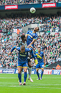 heads clear of Jamille Matt of Plymouth Argyle and team mate Callum Kennedy during the Sky Bet League 2 Play-off Final at Wembley Stadium, London<br /> Picture by Matt Wilkinson/Focus Images Ltd 07814 960751<br /> 30/05/2016