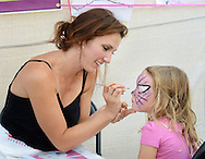 Jess Broderick of Let Jess Do It in New Britain face paints Micka Strigil, 3 of Doylestown during Doylestown Arts Fest  September 10, 2016 in Doylestown, Pennsylvania. (Photo by William Thomas Cain)