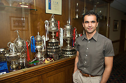 WIGAN, ENGLAND - Monday, August 24, 2009: Wigan Athletic's manager Roberto Martinez in front of some of the trophies won by the town's football and rugby league teams. (Photo by David Rawcliffe/Propaganda)