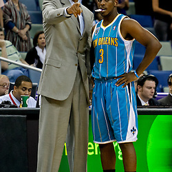 October 9, 2010; New Orleans, LA, USA;  New Orleans Hornets head coach Monty Williams talks with point guard Chris Paul (3) during the first quarter of a preseason game against the Memphis Grizzlies at the New Orleans Arena. Mandatory Credit: Derick E. Hingle