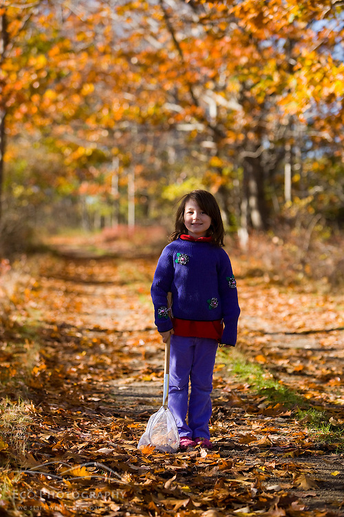 A young girl (age 6) on a woodland trail in Biddeford, Maine