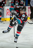 KELOWNA, CANADA - OCTOBER 18:  Tyrell Goulbourne #12 of the Kelowna Rockets takes a shot on the ice as the Prince George Cougars visit the Kelowna Rockets on October 18, 2012 at Prospera Place in Kelowna, British Columbia, Canada (Photo by Marissa Baecker/Shoot the Breeze) *** Local Caption ***