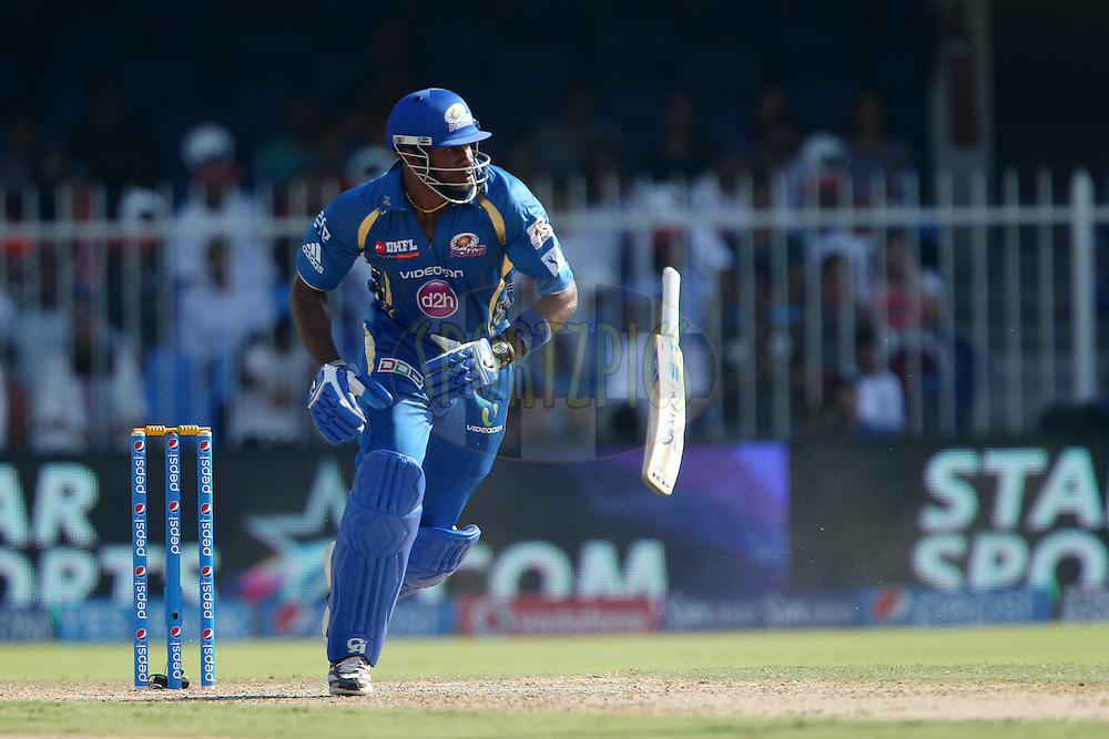 Kieron Pollard of the Mumbai Indians sets off without his bat during match 16 of the Pepsi Indian Premier League 2014 between the Delhi Daredevils and the Mumbai Indians held at the Sharjah Cricket Stadium, Sharjah, United Arab Emirates on the 27th April 2014<br /> <br /> Photo by Ron Gaunt / IPL / SPORTZPICS