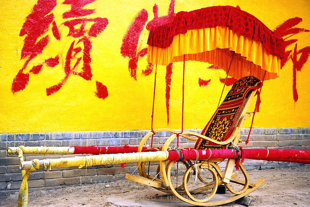 China, Wutai Shan, 2008. A palaquin fit for royalty awaits customers at the bottom of Pusa Ding Temple's 108 stone stairs. Emperors Qianlong and Kangxi once stayed in this magnificent temple in the center of Wutai Shan.