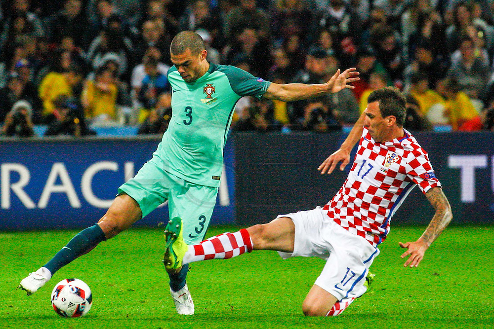 LENS, FRANCE, 06.25.2016 - CROATIA-PORTUGAL - Pepe (E) of Portugal and Mario Mandzukic of Croatia during starting by the 8th-finals of Euro 2016 in Lens in France on Saturday, 25.