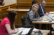 Defense attorney Jessa Nicholson, right, looks on as a representative of the Rape Crisis Center of Madison reads a victim statement during the sentencing hearing for former UW-Madison student Alec Cook in Madison, Wisconsin, Thursday, June 21, 2018.