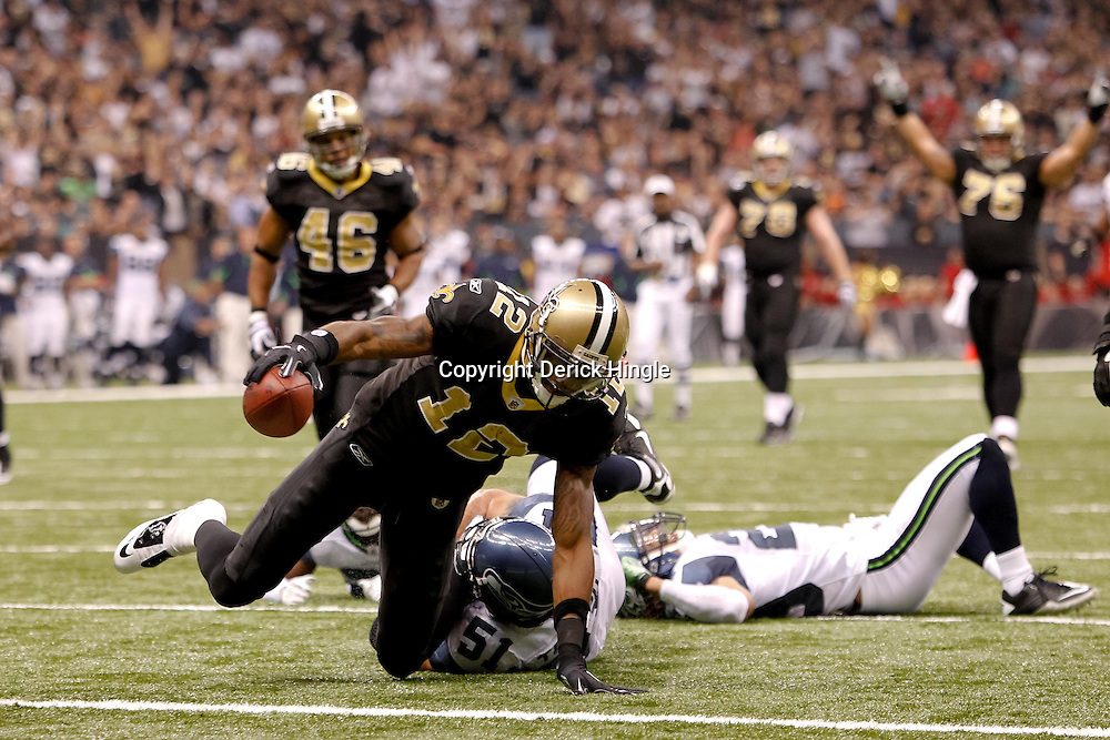November 21, 2010; New Orleans, LA, USA; New Orleans Saints wide receiver Marques Colston (12) reaches over the goal line for a touchdown during the second quarter at the Louisiana Superdome. Mandatory Credit: Derick E. Hingle
