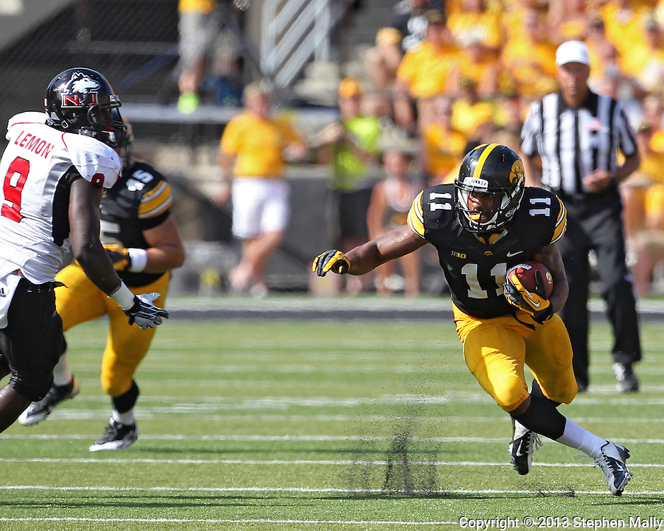 August 31 2013: Iowa Hawkeyes wide receiver Kevonte Martin-Manley (11) looks to change directions after a catch during the second quarter of the NCAA football game between the Northern Illinois Huskies and the Iowa Hawkeyes at Kinnick Stadium in Iowa City, Iowa on August 31, 2013. Northern Illinois defeated Iowa 30-27.