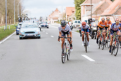 Lizzie Armitstead makes a move, jumping to the opposite side of the road but Carmen Small is straight on her wheel - Women's Gent Wevelgem 2016, a 115km UCI Women's WorldTour road race from Ieper to Wevelgem, on March 27th, 2016 in Flanders, Belgium.