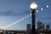 Soft focus overhead lights on the Southbank and the skyline of the City of London - the capital's financial district (aka The Square Mile), on 29th October 2018, in London, England.