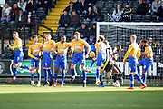 This County free kick crashes into the Mansfield wall  during the EFL Sky Bet League 2 match between Notts County and Mansfield Town at Meadow Lane, Nottingham, England on 16 February 2019.