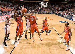Clemson forward/center Trevor Booker (35) and forward James Mays (40) grab a rebound against Virginia.  The Virginia Cavaliers men's basketball team fell the Clemson Tigers at 82-51 the John Paul Jones Arena in Charlottesville, VA on February 7, 2008.