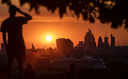 © Licensed to London News Pictures. 24/07/2018. London, UK. The sun sets over London's skyline, after temperatures in the South East of England reached over 30 degrees celsius today. Temperatures are set to rise up to 35 degrees on Thursday, as the UK experiences a prolonged heatwave. Photo credit : Tom Nicholson/LNP