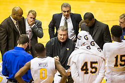Dec 5, 2015; Morgantown, WV, USA; West Virginia Mountaineers head coach Bob Huggins talks with his team during a timeout during the second half against the Kennesaw State Owls at WVU Coliseum. Mandatory Credit: Ben Queen-USA TODAY Sports