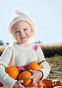 Portrait of a girl holding pumpkins