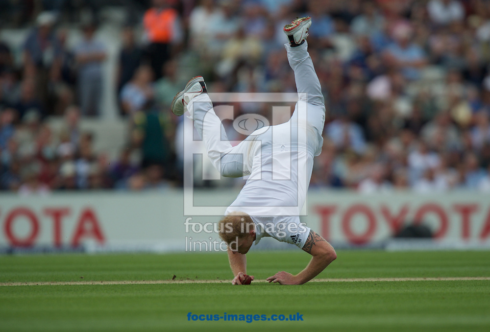 Ben Stokes of England makes an athletic dive to catch the ball and prevent a boundary during the 5th Investec Ashes Test Match match at the Kia Oval, London<br /> Picture by Alan Stanford/Focus Images Ltd +44 7915 056117<br /> 20/08/2015