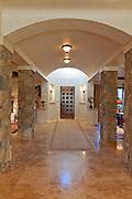 Hallway leading to a door in luxury villa