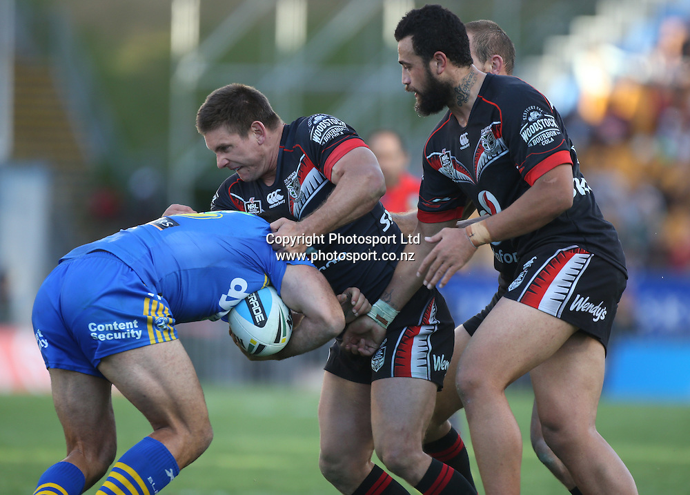 Warriors players  Jacob Lillyman, middle, and Ben Matulino, right, tackle  Eels player Reece Robinson during  the NRL Rugby League match between the NZ Warriors and the Parramatta Eels played at Mt Smart Stadium in South Auckland on the 21st March 2015. <br /> <br /> Copyright Photo; Peter Meecham/ www.photosport.co.nz