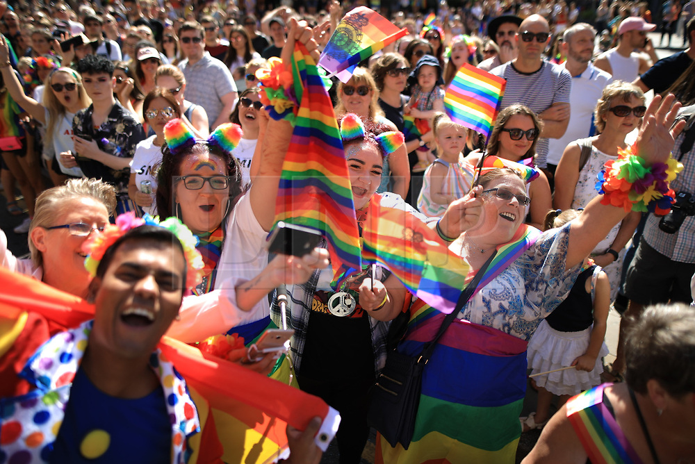 © Licensed to London News Pictures . 24/08/2019. Manchester, UK. Manchester's annual Gay Pride parade passes through the city centre , watched by thousands of people . Manchester's Gay Pride festival , which is the largest of its type in Europe , celebrates LGBTQ+ life . Photo credit: Joel Goodman/LNP
