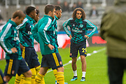 Matteo Guendouzi (#29) of Arsenal FC warms up with team mates during the Premier League match between Newcastle United and Arsenal at St. James's Park, Newcastle, England on 11 August 2019.