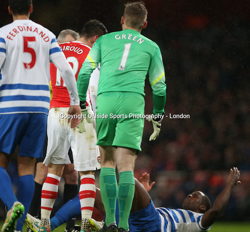 26 December 2014 Premier League Football - Arsenal v Queens Park Rangers ;  Nedum Onuoha of Rangers lies on the floor after eing headbutted by Olivier Giroud of Arsenal.<br /> Photo: Mark Leech.