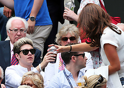 Image ©Licensed to i-Images Picture Agency. 26/06/2014. London, United Kingdom.  Niall Horan from One Direction is given a drink  in the Centre Court  on day four of the Wimbledon Tennis Championships. Picture by Stephen Lock / i-Images
