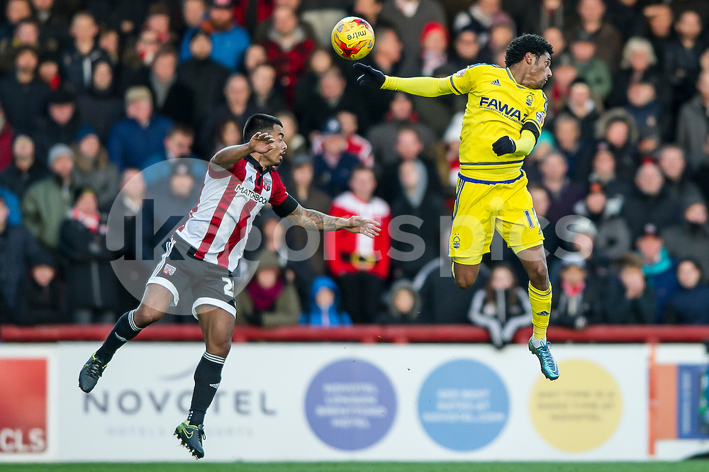 Nico Yennaris of Brentford and Ryan Mendes of Nottingham Forest during the Sky Bet Championship match between Brentford and Nottingham Forest at Griffin Park, London, England on 21 November 2015. Photo by Salvio Calabrese.