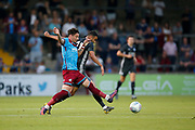 Adam Hammill Of Scunthorpe United challenges Rachid Ghezzal of Leicester City during the Pre-Season Friendly match between Scunthorpe United and Leicester City at Glanford Park, Scunthorpe, England on 16 July 2019.