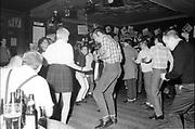 Crowd of Skins, dancing, UK, 1980s.