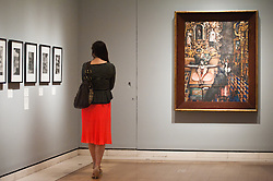 """Mexico: A Revolution in Art opens at the Royal Academy of Arts.<br /> A woman walks next to work by Edward Burra entitled """"Mexican Church, 1938"""" at the exhibition """"Mexico: A Revolution in Art, 1910 - 1940"""" which opens at the Royal Academy of Arts on the 6th of July. The show features over 120 paintings and photographs and examines the intense period of artistic creativity that took place in Mexico at the beginning of the 20th century,<br /> London, United Kingdom,<br /> Tuesday, 2nd July 2013<br /> Picture by Piero Cruciatti / i-Images"""