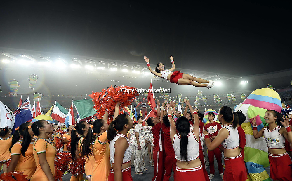 28.08.2014. Nanjing, China.  Artists jubilate after the closing ceremony of Nanjing 2014 Youth Olympic Games in Nanjing, capital of east Chinas Jiangsu Province, Aug. 28, 2014.