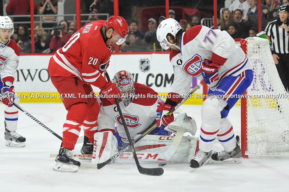 29 Dec 2014:  Carolina Hurricanes Center Riley Nash (20) [6230] has a shot stopped by Montreal Canadiens Goalie Carey Price (31) [4960] in the first period of a game between the Montreal Canadiens and Carolina Hurricanes at the PNC Arena in Raleigh, NC.