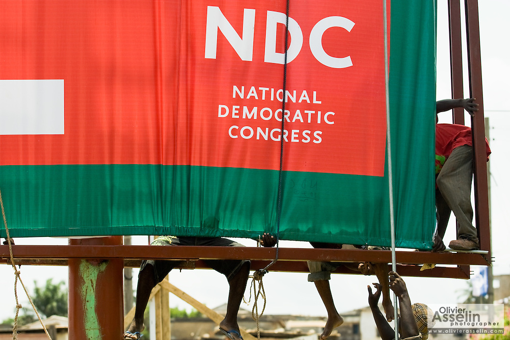 Workers set up a large billboard promoting the National Democratic Congress (NDC) ahead of presidential elections in Cape Coast, Ghana on Sunday September 7, 2008.