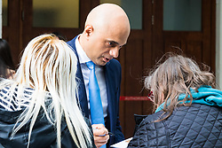 London, October 22 2017. Communities and Local Government Secretary Sajid Javid signs autographs as he leaves the BBC after appearing on the Andrew Marr show at the BBC New Broadcasting House in London. © Paul Davey