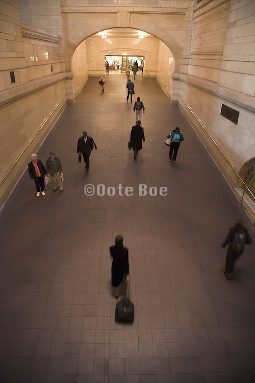commuters walking through a large hallway Grand Central New York City