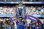 Chelsea Defender Cesar Azpilicueta (28) celebrates with the trophy during the Premier League match between Chelsea and Sunderland at Stamford Bridge, London, England on 21 May 2017. Photo by Andy Walter.