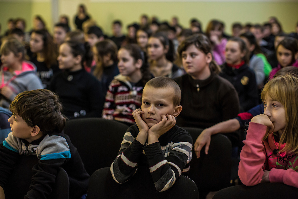 Students at Boarding School Number 1 attend a presentation by the Swiss Foundation for Mine Action regarding safety around landmines and unexploded ordnance on Friday, February 12, 2016 in Slovyansk, Ukraine.