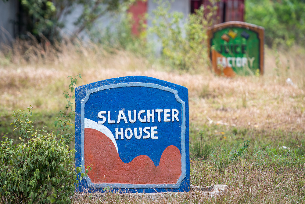 "A colorful tombstone reads ""Slaughter House"" in Ganta, Liberia"