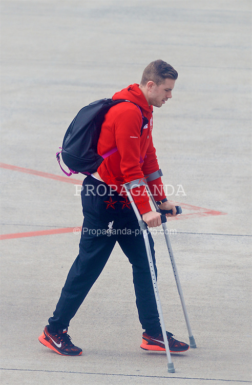 DORTMUND, GERMANY - Friday, April 8, 2016: Liverpool's captain Jordan Henderson departs Dortmund Airport on crutches after sustaining a knee injury during his side's UEFA Europa League Quarter-Final 1st Leg match against Borussia Dortmund last night. (Pic by David Rawcliffe/Propaganda)