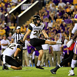 Oct 15, 2016; Baton Rouge, LA, USA;  Southern Miss Golden Eagles place kicker Parker Shaunfield (21) kicks during the first half of a game against the LSU Tigers at Tiger Stadium. Mandatory Credit: Derick E. Hingle-USA TODAY Sports