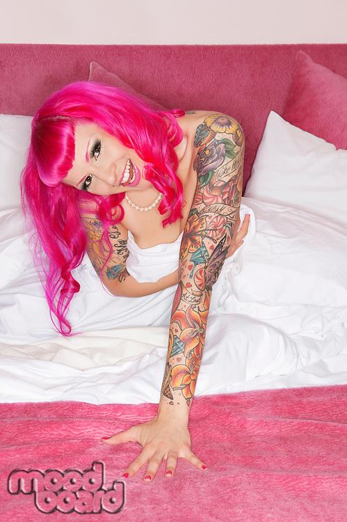 Erotic tattooed woman laughing